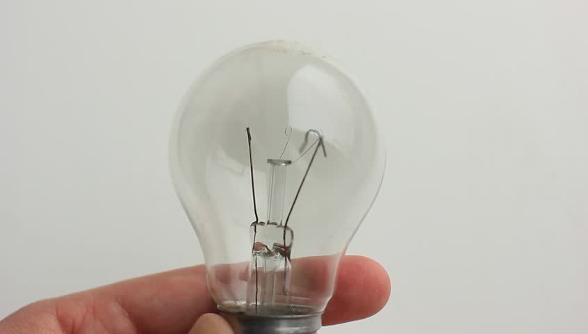 Burned out bulb in hand | Shutterstock HD Video #19332601