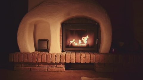 4K Fireplace with Burning Wood Logs.  Warm cozy fire in a hearth or fire pit. Calm Background. Autumn and Winter holidays. Chalet or Cabin comfort.