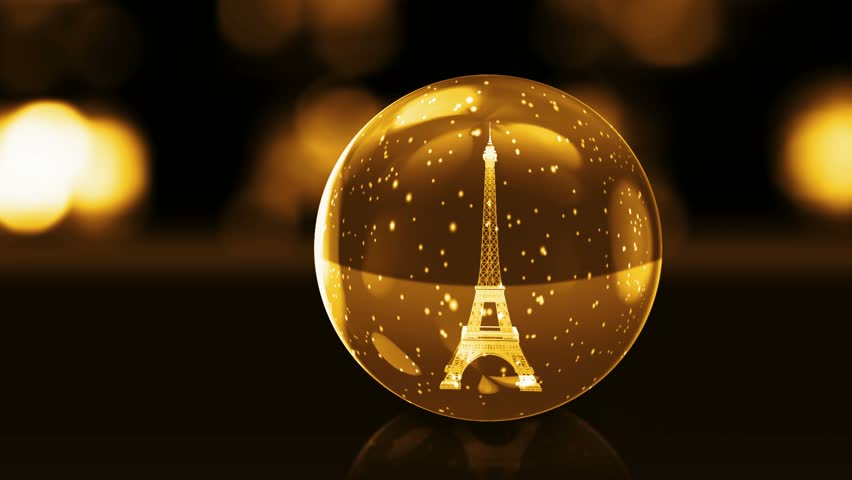 Eiffel Tower in golden glass ball with snow