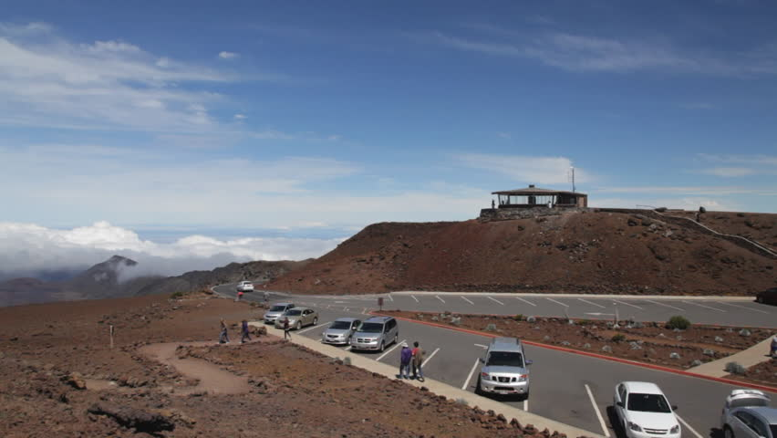 A group of visitors on the haleakala summit on puu ulaula red a group of visitors on the haleakala summit on puu ulaula red hill overlooking haleakala crater and the summit shelter and parking lot on maui publicscrutiny Image collections