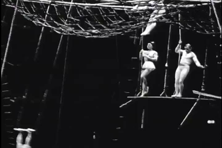 Performers put on a show on the flying trapeze at a circus in the 1930s. (1930s)