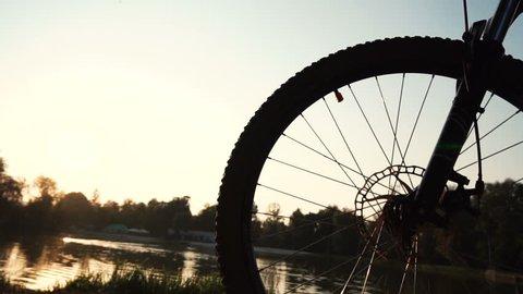 Man rides a bike near lake