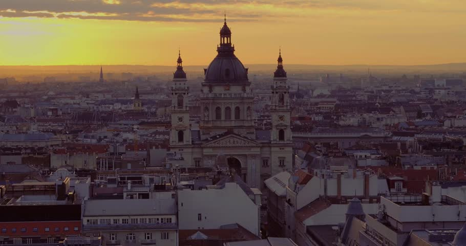 Aerial video taken by a drone shows the St. Stephens Basilica and downtown Budapest in sunrise