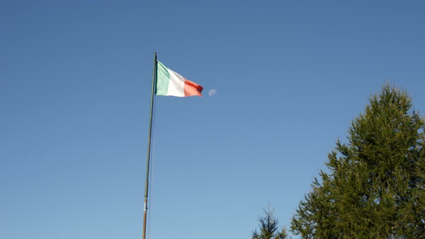 An italian flag and  the half moon in a clear blue sky. | Shutterstock HD Video #19561588