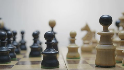 Chess figures spread on the chess board. Board makes a hundred eighty degree rotation.