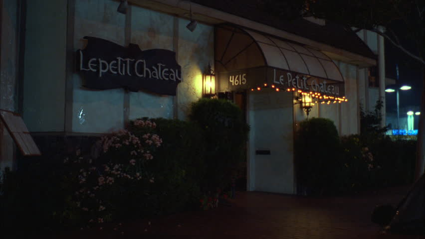 Night Tight entrance Raked left Le Petit Chateau quaint French restaurant | Shutterstock HD Video #19628761