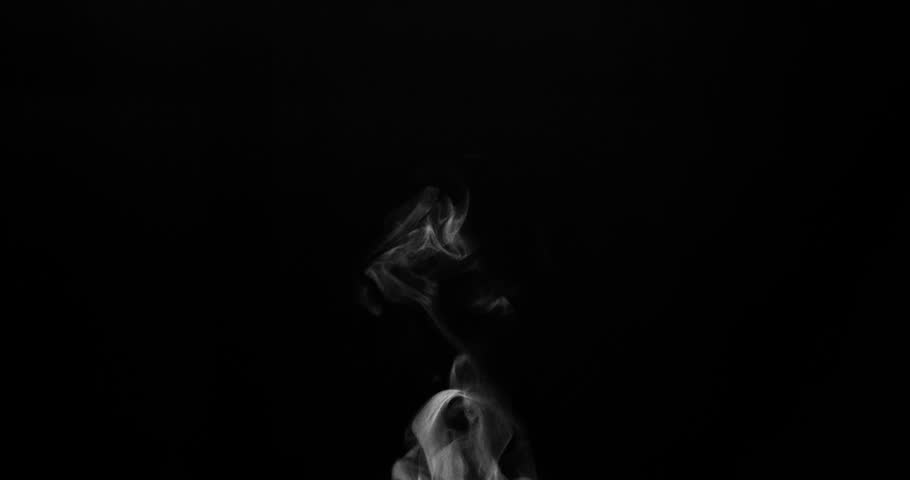 Weak Jet of Steam from the Hot Cup. White steam rises light, graceful twists on a black background. Shooting at a rate of 120fps. Footage is perfect for the top layer with different blending modes