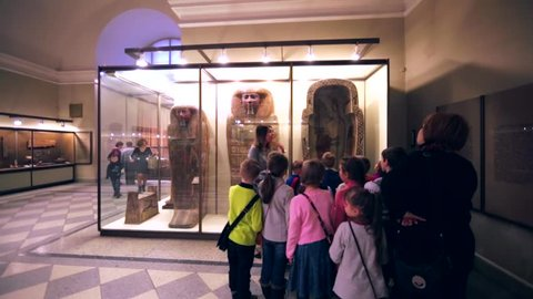 SAINT PETERSBURG, RUSSIA - FEBRUARY 12, 2016: Children and museum guide are near egypt sarcophaguses in Hermitage, one of the largest museums in the world, founded in 1764 by Catherine II.