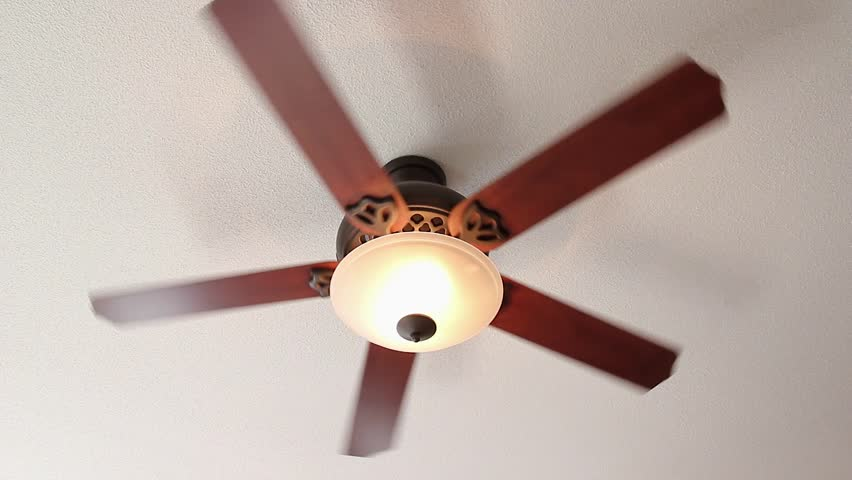 A ceiling fan spins on high setting with light stock footage video a ceiling fan spins on high setting with light stock footage video 1967911 shutterstock mozeypictures Images