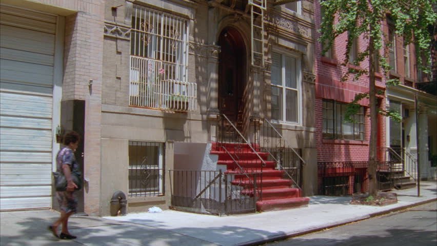 Day Tilt up left Raked left 5 story stone eastern apartment building w fire escapes | Shutterstock HD Video #19736011