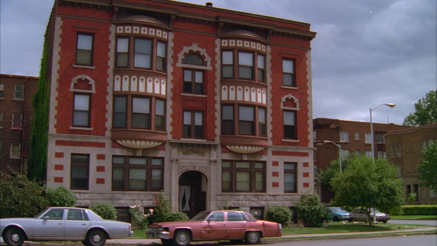 Brick Apartment Building pan over to a victorian style red brick building. stock footage