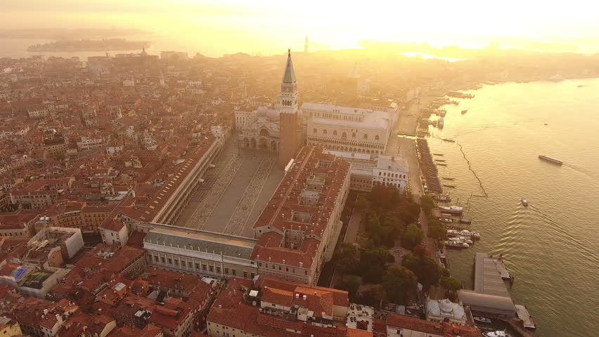 Aerial view of Venice, St Mark's square. Scenic video taken at sunrise. San Marco square in Venice, Italy it's the principal public square of Venice, where it is generally known just as the Piazza. | Shutterstock HD Video #19764271