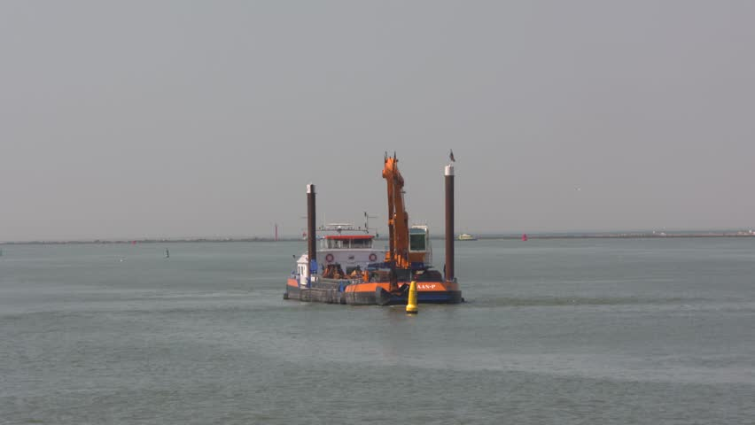 SEAPORT ROTTERDAM -  JULY 2016: Crane vessel operating at Breeddiep, an important connection between the Caland Canal and the Nieuwe Waterweg opposite Hoek van Holland.