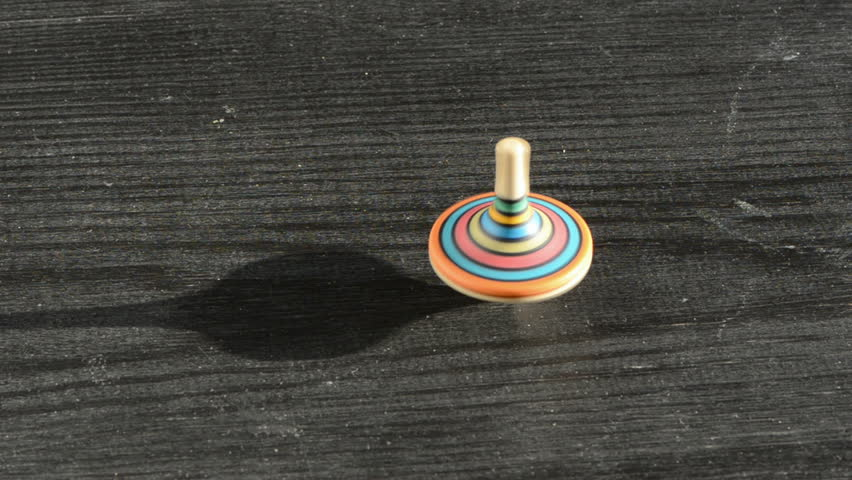 Colorful Wooden Top On The Old Black Table