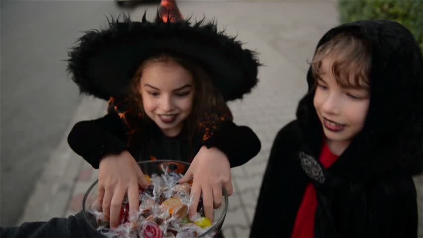 Halloween, Kids Want Halloween Candy, Children wearing witch costumes with hats, Kids trick or treat. | Shutterstock HD Video #19801111