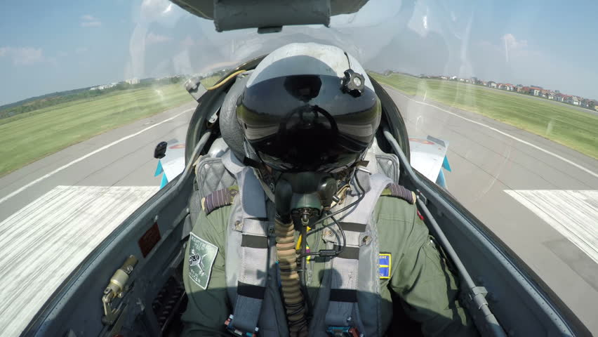 POV shot from the cockpit of a fighter plane - shot of a fighter jet taking off from the ground.