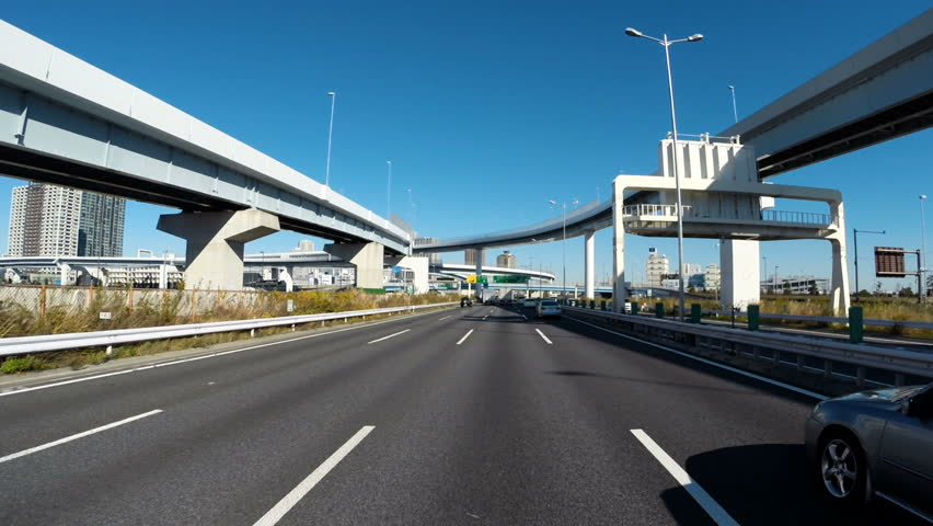 SHINONOME JCT, JAPAN. DECEMBER 14 - Clear blue skies and overpasses through the Shinonome Junction on the Bayshore Highway in Tokyo. | Shutterstock HD Video #19805911