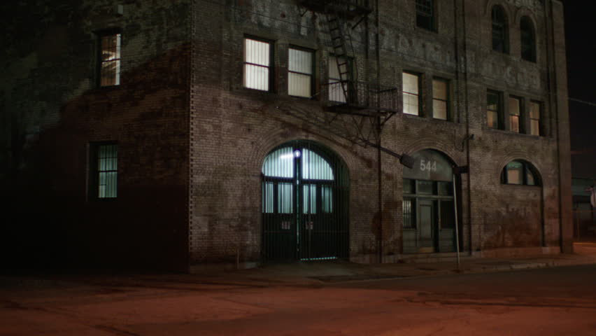 Night Raked Left Tight Corner 3 Story Distressed Run Down Brick Industrial Building Warehouse Loft Apartment