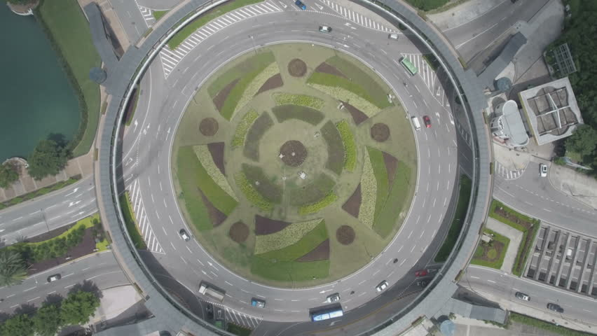 Aerial static drone shot of a roundabout in Macau.