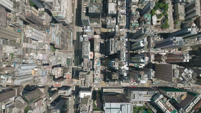 Urban panorama seen from above, tiny cars and buses drive through dense streets of Kowloon, among skyscrapers, office towers, residential apartments, in one of Asia's most vibrant cities Hong Kong.   Shutterstock HD Video #19843177