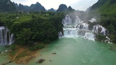 Waterfall aerial view, flying on a beautiful landscape, a suggestive aerial video above Ban Cioc waterfall in Vietnam, Asia