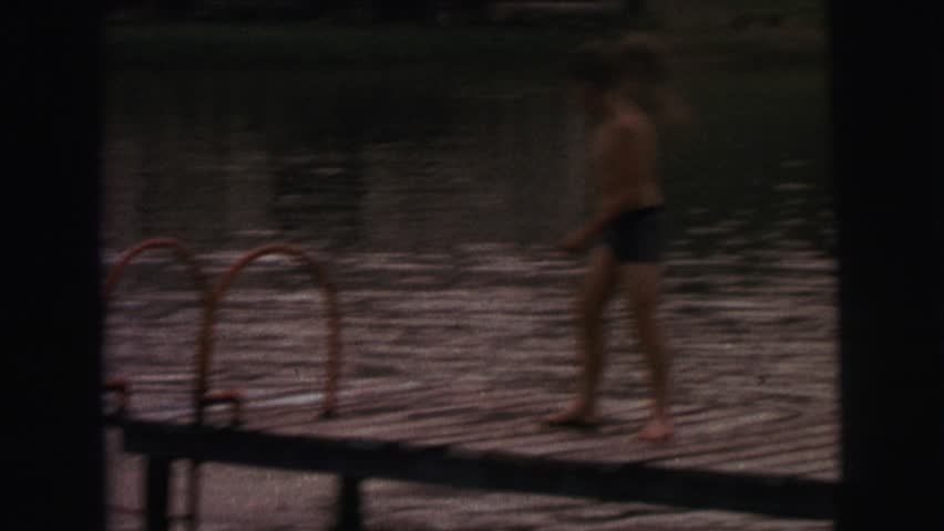 LYNBROOK, NEW YORK 1974: a child is seen dipping in a pool   Shutterstock HD Video #19957591
