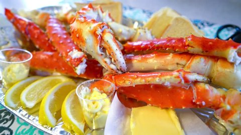 Red king crab legs with fresh lemon slices. Delicious seafood and luxury restaurant menu.