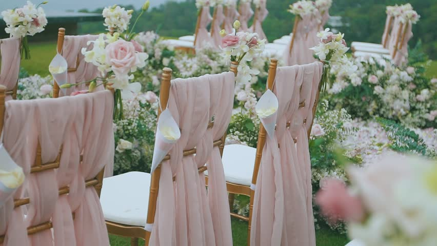 Wedding scenery in the open air bouquets of flowers the invited dolly of rows of chairs at a wedding ceremony from the aisle hd stock junglespirit Image collections