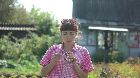 girl eating yogurt outdoors