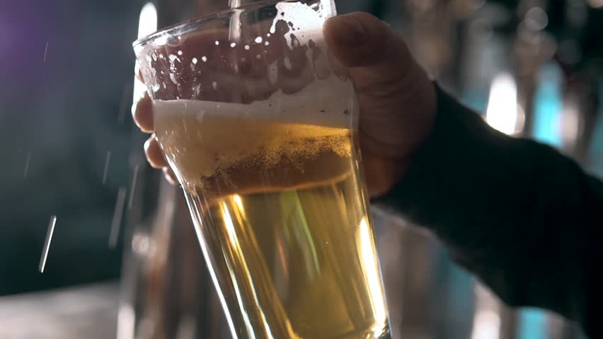Beer into glass with a lot of bubles and foam super close up slow motion. #20078830