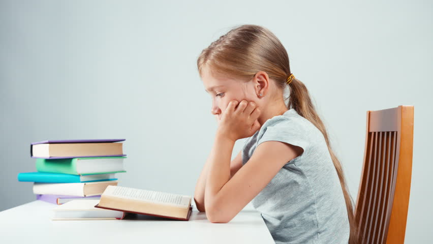 Portrait profile girl child 7-8 years old reading textbook. Isolated | Shutterstock HD Video #20087041