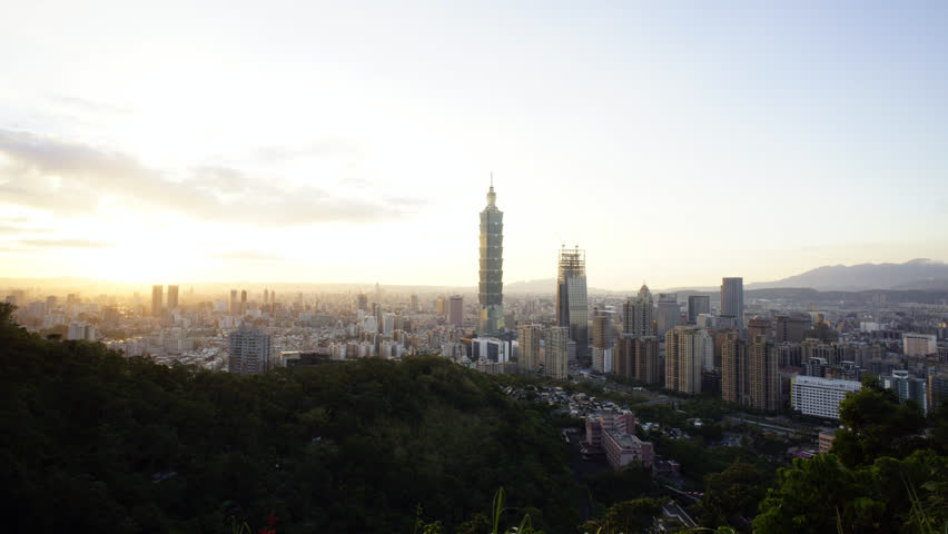 Taipei city in the late evening with building lights on and off, car trails, time-lapse | Shutterstock HD Video #20118361
