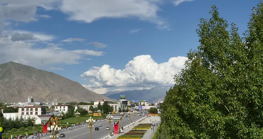 4k Lhasa traffic,Tibet.white puffy cloud mass in the blue sky. gh2_08918_4k