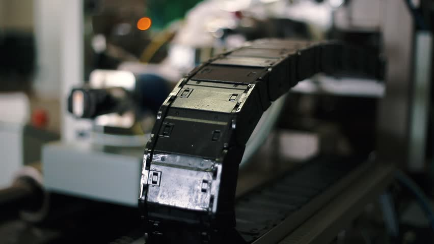 Production department at the company. Production of the film for sausages. Rotating elements. High-tech equipment. Items of production equipment close-up. Warm color grading. Flexible cable channel | Shutterstock HD Video #20184961
