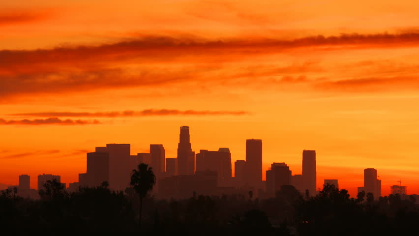 Time Lapse of the sun rising from behind the building of downtown Los Angeles. | Shutterstock HD Video #20189431