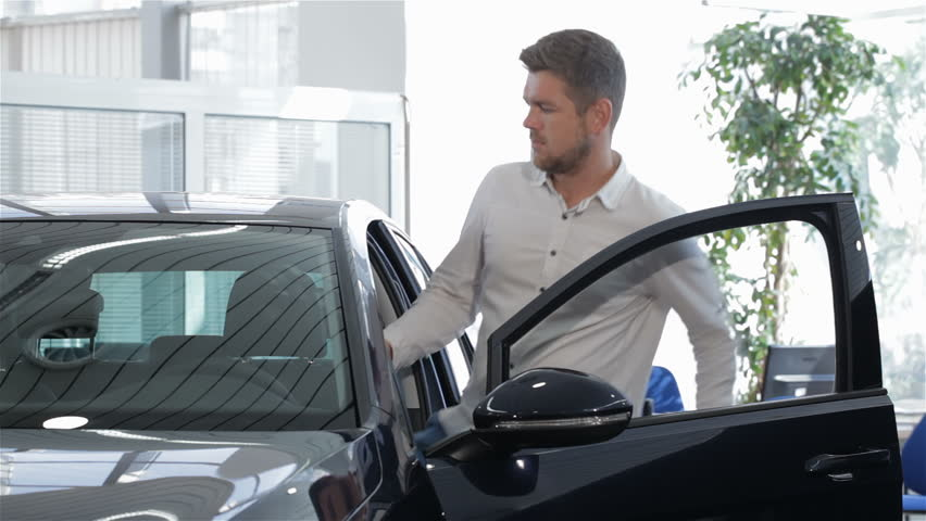 Young Successful Casual Man Getting Convertible Car Against Clear