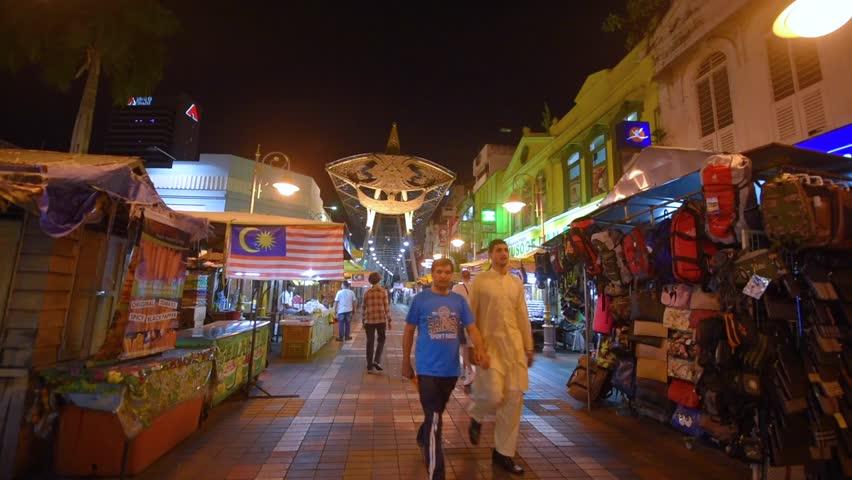 KUALA LUMPUR, MALAYSIA - SEPTEMBER 16, 2016: Local people and tourists browse the stalls in the Kasturi Walk next to the Pasar Seni market in Kuala Lumpur city center.