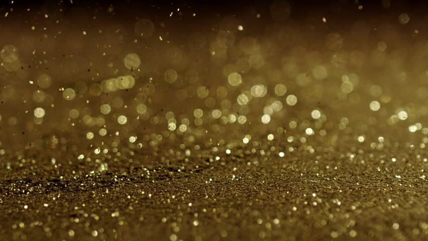 Golden glitter exploding , Red Epic slow motion clip | Shutterstock HD Video #20265541