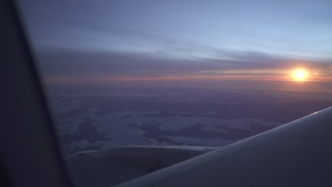 Looking out of a plane window at the southern alps of New Zealand