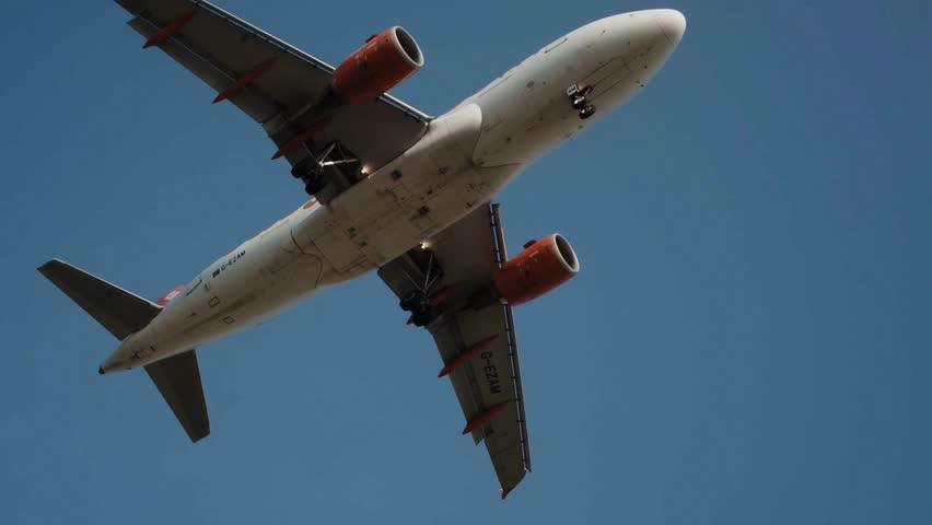 Big airplane landing in airport, back view, handheld shooting
