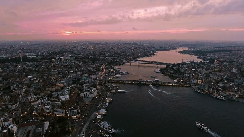 4K UHD The New Istanbul Skyline Buildings Aerial Video with Galata Tower in Eminonu, Halic, Karakoy and a Part of Goldenhorn at Sunset Dusk Time with Beautiful Sky