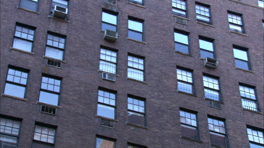 day raked left hold up mid section large upscale nice brick apartment modern apartment next it then pan left slight push see more brick apt, green trees, fall