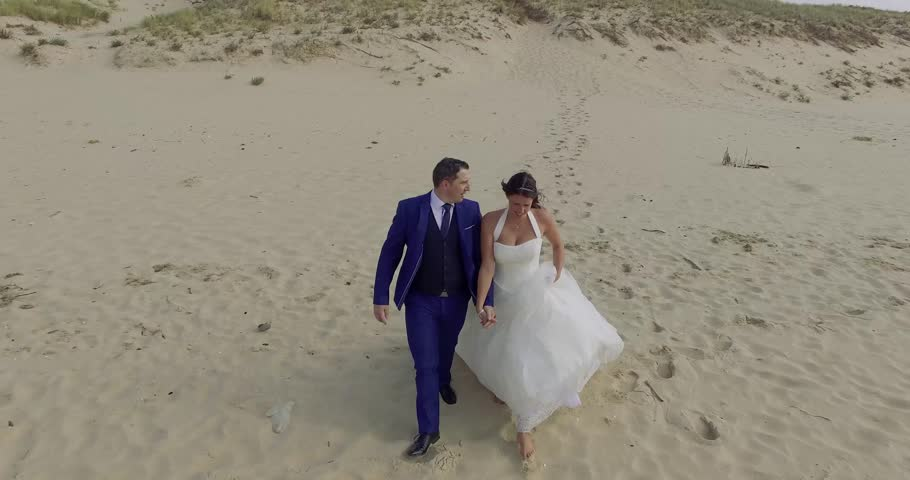 Happy just married young wedding couple celebrating and have fun at beautiful beach sunset | Shutterstock HD Video #20445931