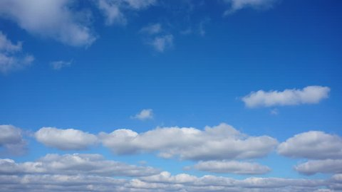 Clouds in the blue sky above the city. Timelapse.
