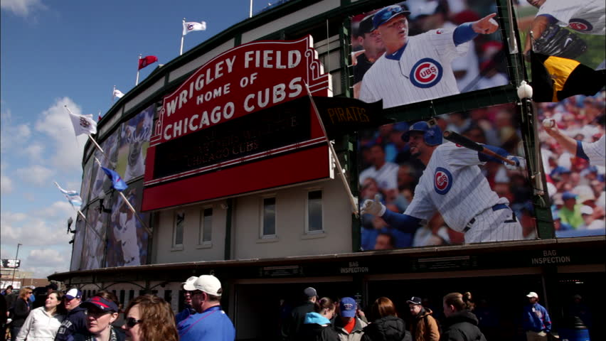 day establish entrance Wrigley Field baseball stadium Welcome Wrigley Field Home Chicago Cubs Pirates flag, See people jackets hanging around, can be used process plate shot green screen b font color