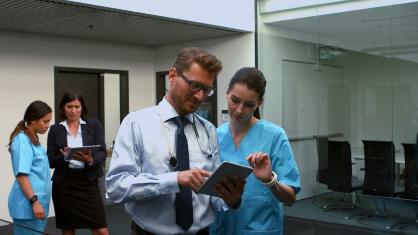 Doctors discussing over digital tablet in hospital with nurse 4k | Shutterstock HD Video #20489284