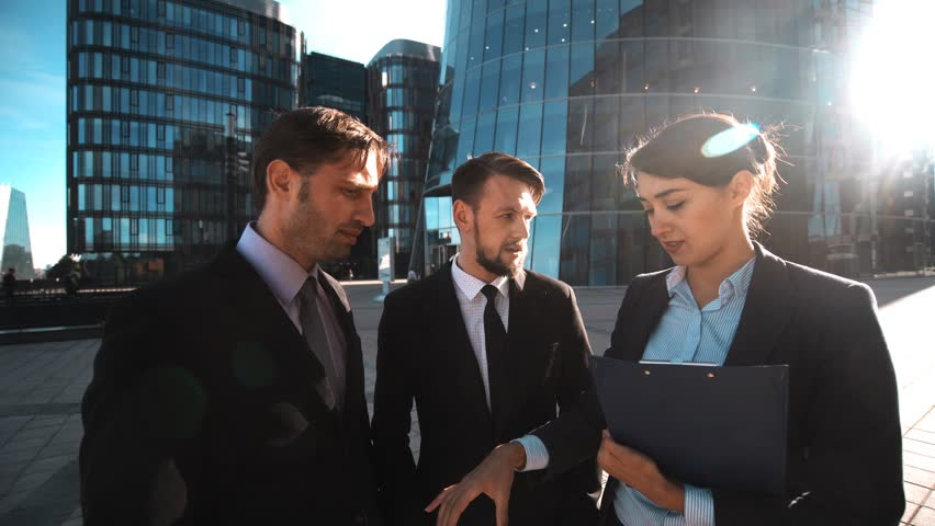 4k. POV. Your family calling. Team of business people give hand with mobile phone to You. Textpad. Modern glass business centre district background. Teal orange sunrise. Please, answer call concept.