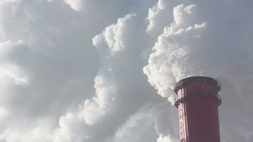 Industrial chimney belching out clouds of smoke into the atmosphere in an air pollution concept