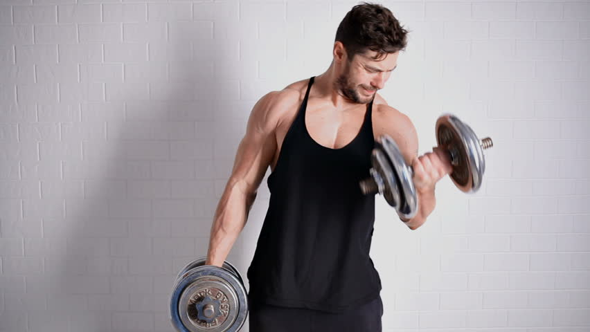 Strong topless man doing exercise with dumbbells | Shutterstock HD Video #20531161
