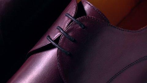 New brown leather bespoke mens boots. 4K macro pan shot, rack focus